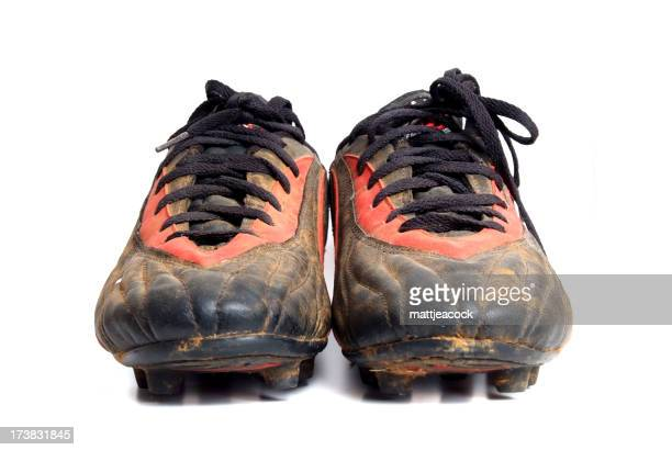 Football boots against a white background