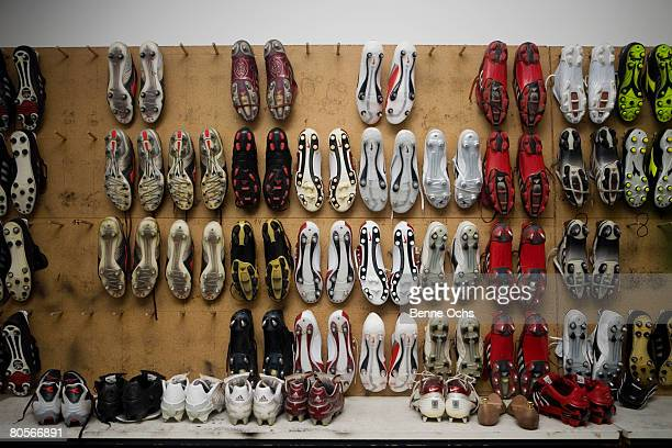 Football boots hanging on a wall