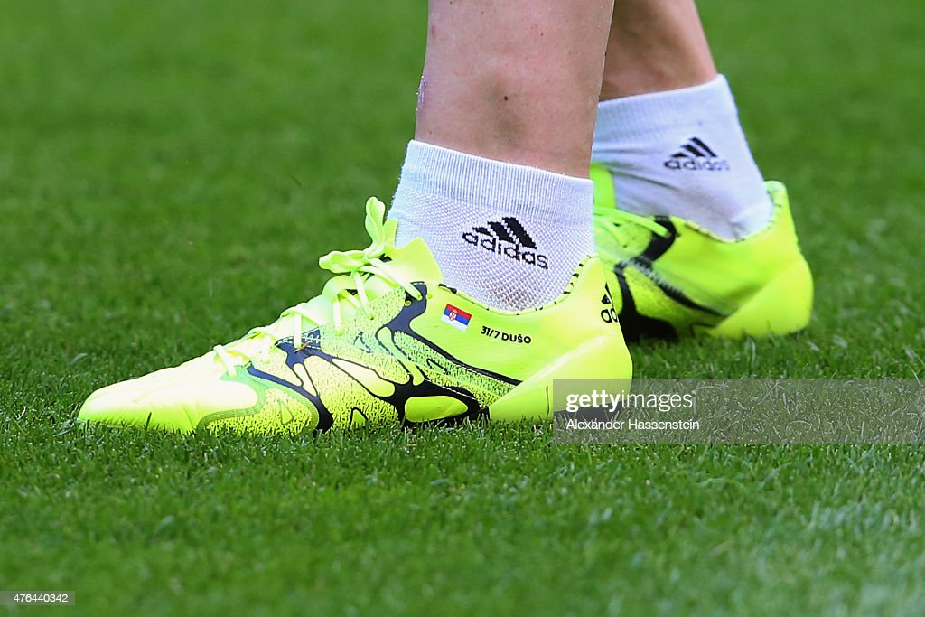Football boots of <a gi-track='captionPersonalityLinkClicked' href=/galleries/search?phrase=Bastian+Schweinsteiger&family=editorial&specificpeople=203122 ng-click='$event.stopPropagation()'>Bastian Schweinsteiger</a> pictured during a training session at RheinErnergieStadion ahead of their international friendly match against USA, on June 9, 2015 in Cologne, Germany.