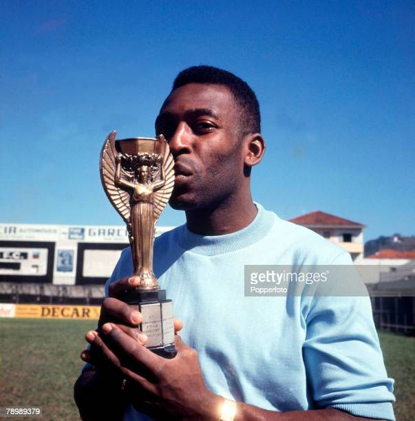 Football Brazilian legend Pele one of the stars of the victorious Brazil team of the 1970 World Cup Finals in Mexico kisses the Jules Rimet trophy...