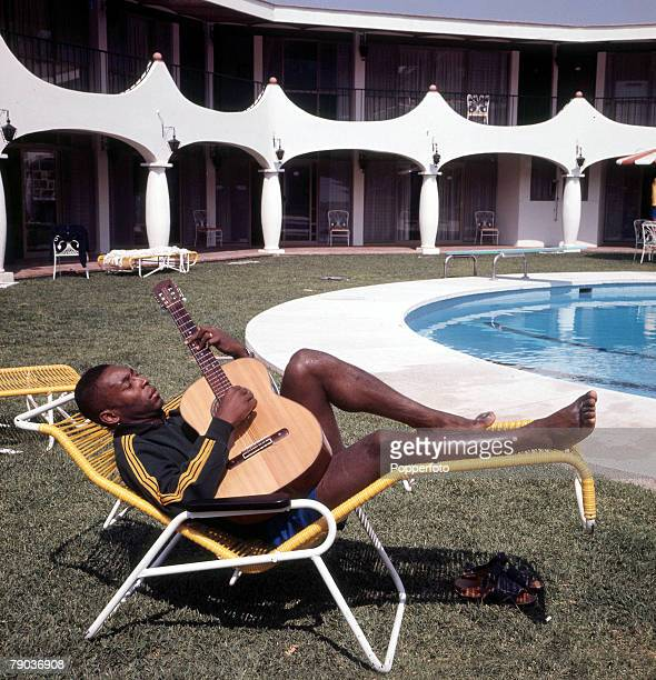 Football Brazilian legend Pele one of the stars of the victorious Brazil team of the 1970 World Cup Finals in Mexico relaxes by the swimming pool in...