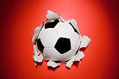 A football break through a wall