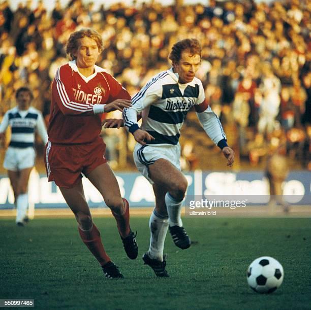 football Bundesliga 1979/1980 Wedau Stadium MSV Duisburg versus 1 FC Cologne 02 scene of the match Bernd Schuster left and team leader Bernard Dietz