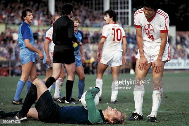football Bundesliga 1983/1984 Grotenburg Stadium FC Bayer 05 Uerdingen versus Bayer 04 Leverkusen 21 scene of the match keeper Werner Vollack injured...