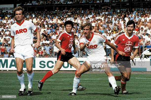 football Bundesliga 1983/1984 Ulrich Haberland Stadium Bayer 04 Leverkusen versus 1 FC Nuremberg 30 scene of the match fltr Norbert Eder BumKun Cha...