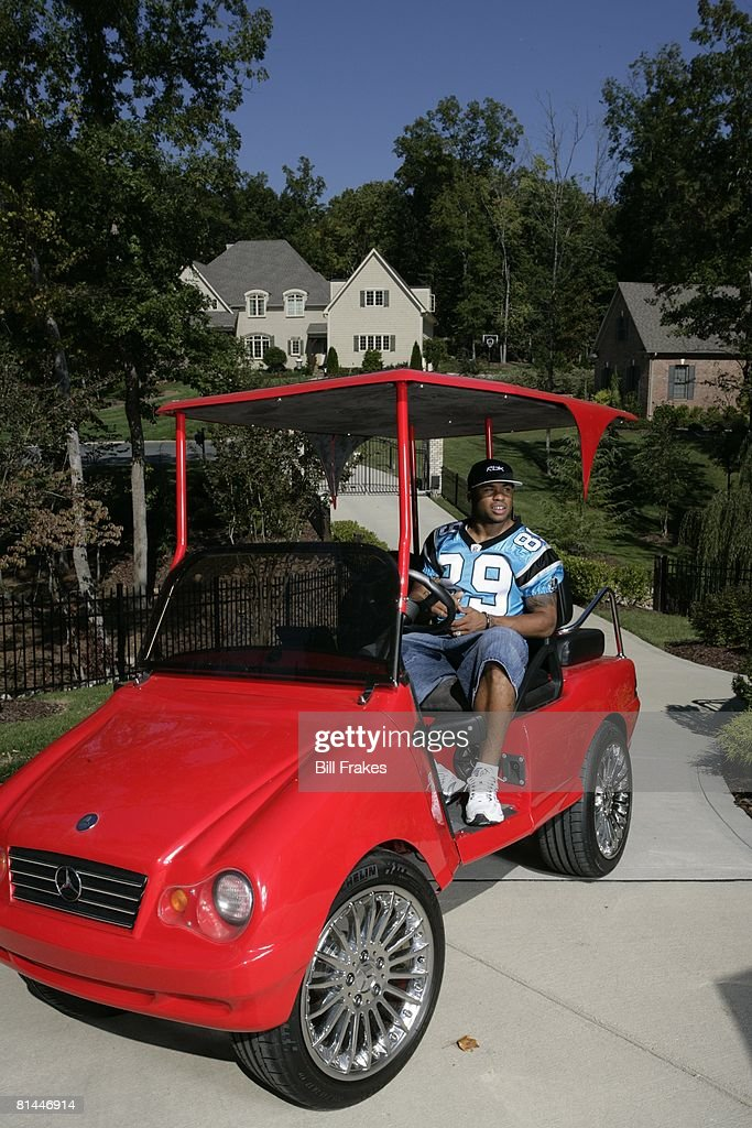 Casual portrait of Carolina Panthers Steve Smith (89) riding custom Mercedes Benz golf cart outside his house, NC 10/3/2006