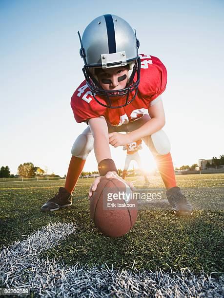 Football center ready to snap football