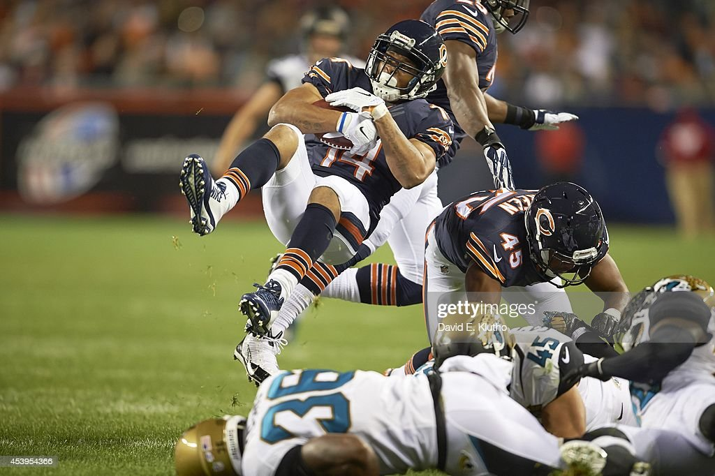 Chicago Bears Eric Weems (14) in action, holding ball suspended in midair vs Jacksonville Jaguars during preseason game at Soldier Field. David E. Klutho TK1 )