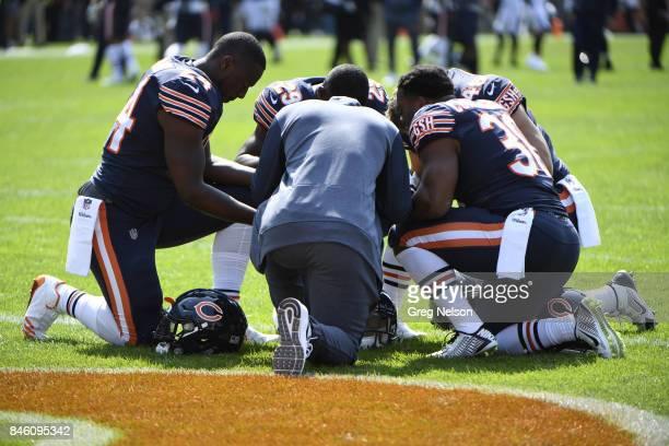 Chicago Bears Jordan Howard Tarik Cohen Michael Burton and Benny Cunningham praying on field after game vs Atlanta Falcons at Soldier Field Chicago...