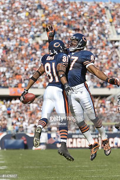 Football Chicago Bears Rashied Davis victorious chest bumping with Muhsin Muhammad after scoring touchdown vs Buffalo Bills Chicago IL 10/8/2006