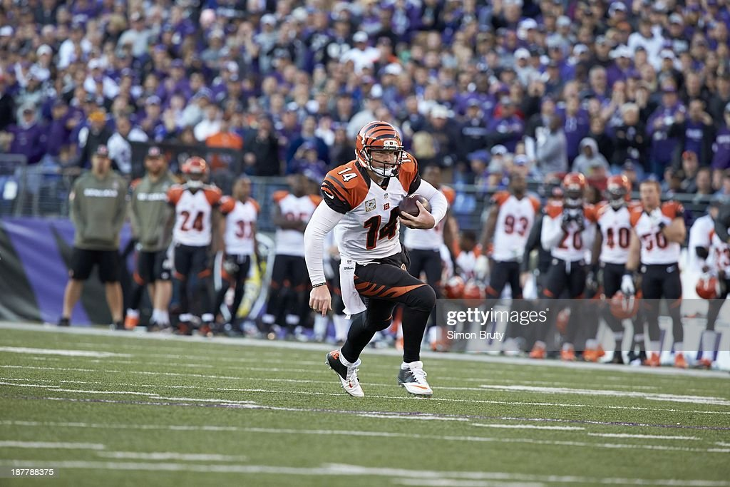 Cincinnati Bengals QB Andy Dalton (14) in action, rushing vs Baltimore Ravens at M&T Bank Stadium. Simon Bruty F290 )