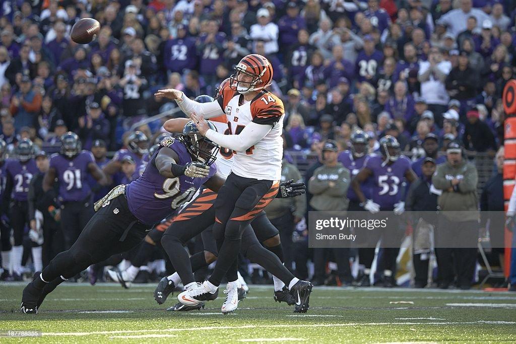 Cincinnati Bengals QB Andy Dalton (14) in action under pressure vs Baltimore Ravens Pernell McPhee (90) at M&T Bank Stadium. Simon Bruty F5 )