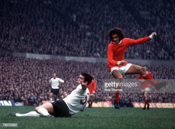 Football Circa 1960's Manchester United's George Best shoots past the sliding tackle of Liverpool's Ron Yeates during a league match