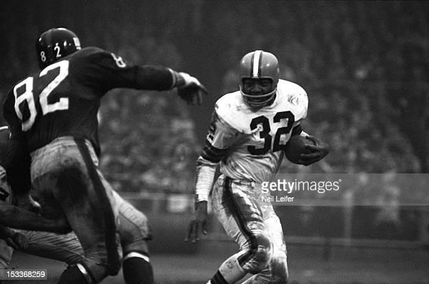 Cleveland Browns Jim Brown in action vs New York Giants Tom Scott at Yankee Stadium Bronx NY CREDIT Neil Leifer