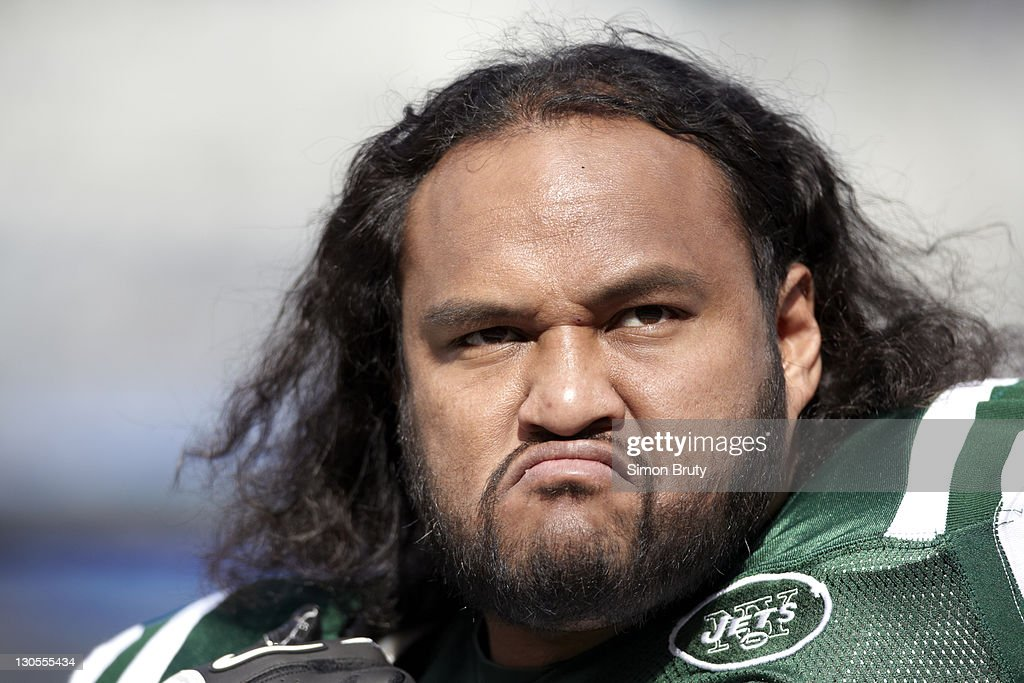 Closeup of New York Jets <b>Sione Pouha</b> (91) before game vs San Diego Chargers - football-closeup-of-new-york-jets-sione-pouha-before-game-vs-san-at-picture-id130555434