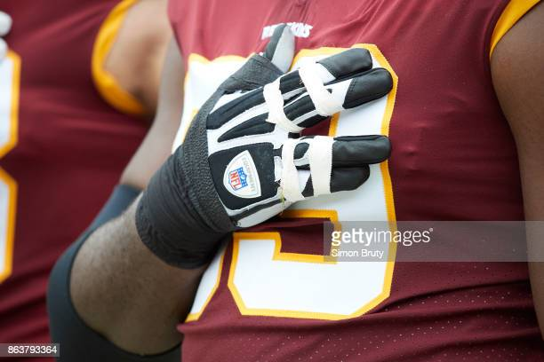 Closeup of Washington Redskins TJ Clemmings with hand over heart during anthem before game vs San Francisco 49ers at FedEx Field Landover MD CREDIT...