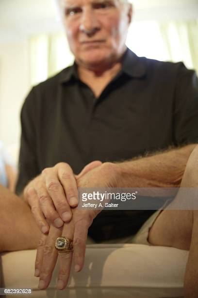 Closeup portrait of former Miami Dolphins linebacker Nick Buoniconti posing with his Super Bowl ring during photo shoot at home Buoniconti who played...