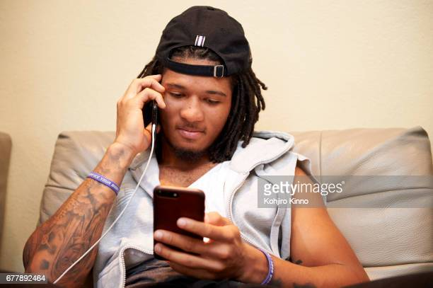 Closeup portrait of former Washington cornerback Sidney Jones on his phone while watching Round 2 of the NFL Draft on Friday at home Jones a...