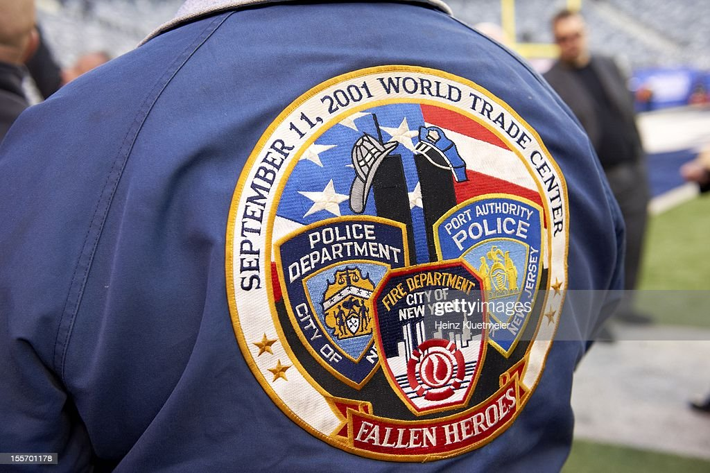 Closeup view of Fallen Heroes World Trade Center patch on jacket before New York Giants vs Pittsburgh Steelers game. Heinz Kluetmeier F78 )