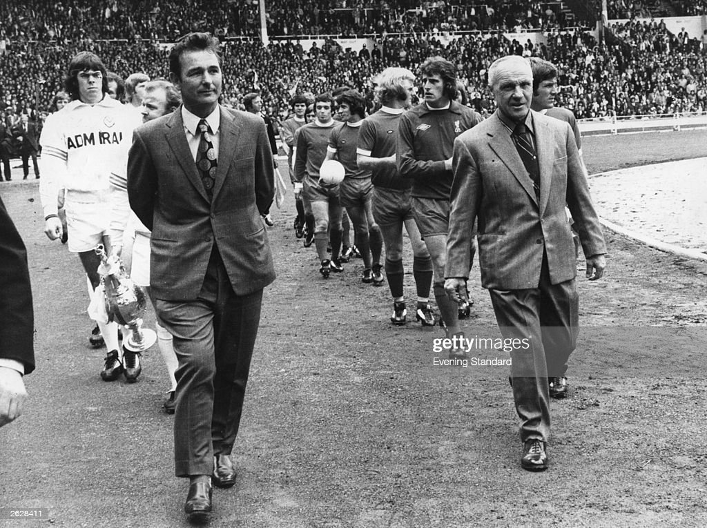 Football Club managers Brian Clough and Bill Shankly lead out their teams at Wembley Stadium for the Charity Shield match between league champions...