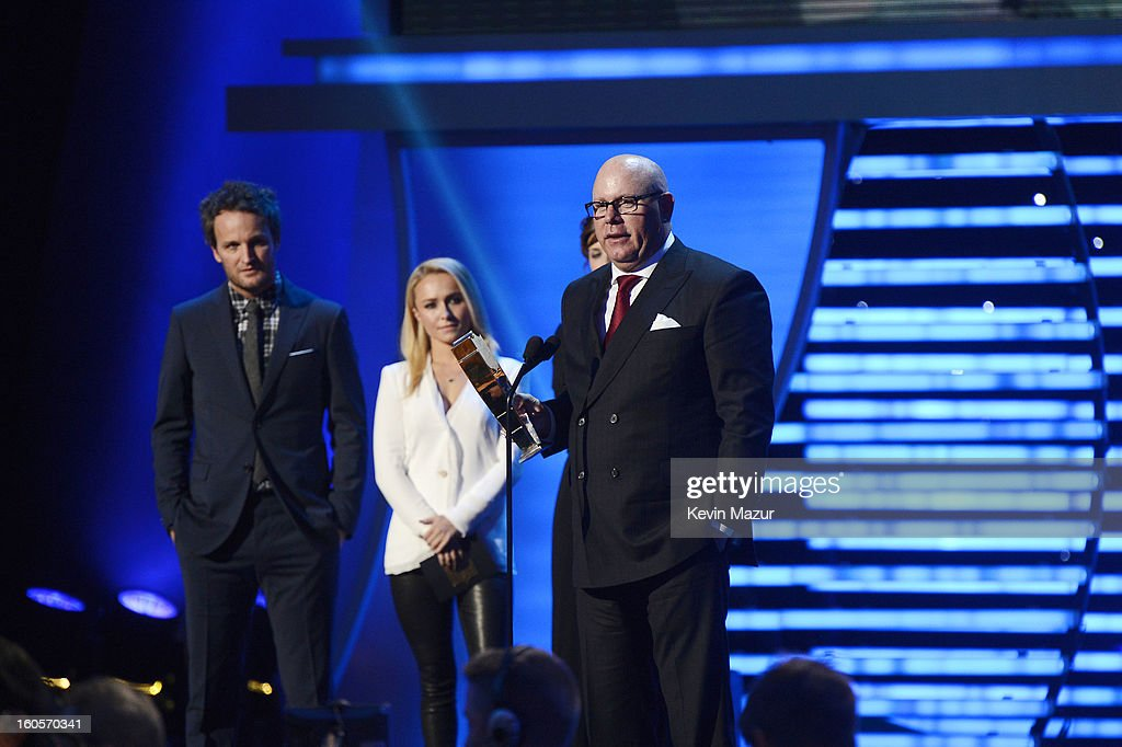 Football coach Bruce Arians accepts an award as actor Jason Clarke (L) and others look on at the 2nd Annual NFL Honors at the Mahalia Jackson Theater on February 2, 2013 in New Orleans, Louisiana.