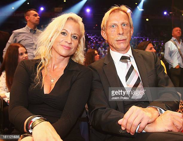 Football coach Christoph Daum is seen with his wife Angelica prior to the WBA and IBF middleweight world championship fight between Felix Sturm and...