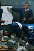 Football coach diagramming play at halftime