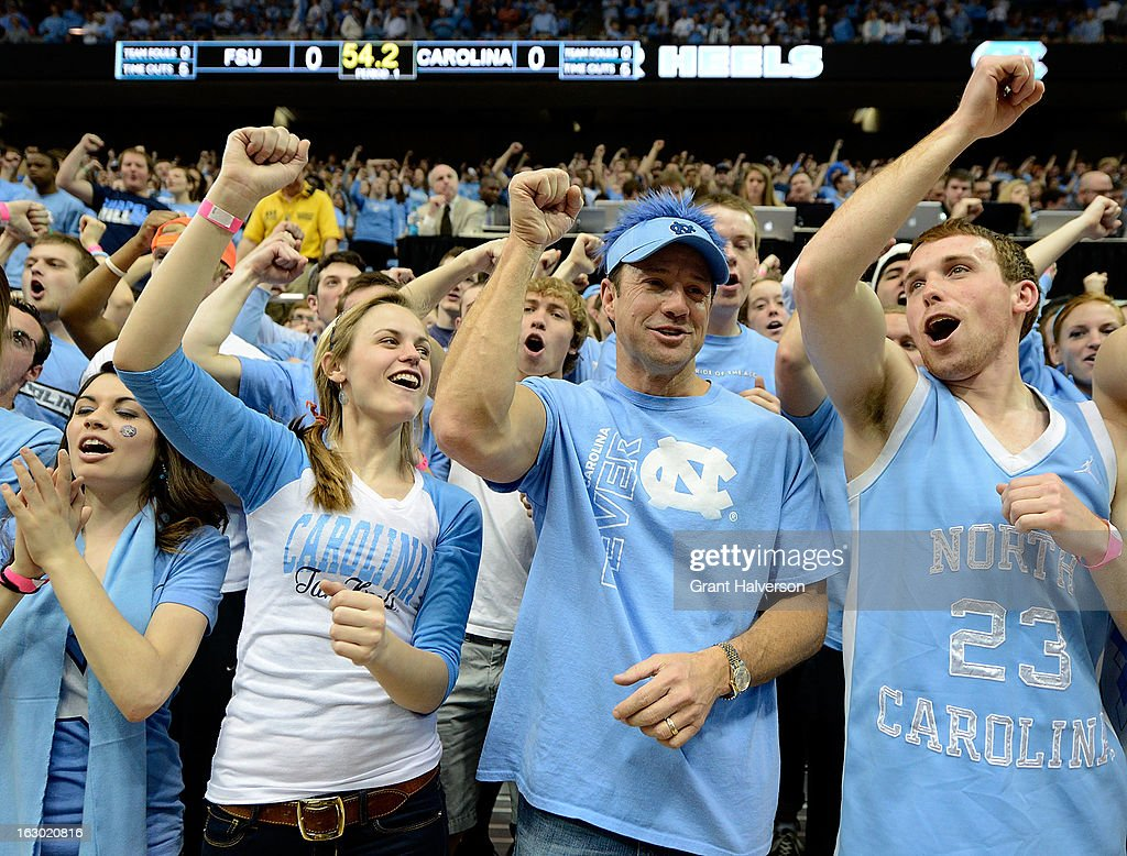 Football coach Larry Fedora of the North Carolina Tar Heels, second from right, joins the student section to cheer during during a game against the Florida State Seminoles at Dean Smith Center on March 3, 2013 in Chapel Hill, North Carolina. North Carolina won 79-58.