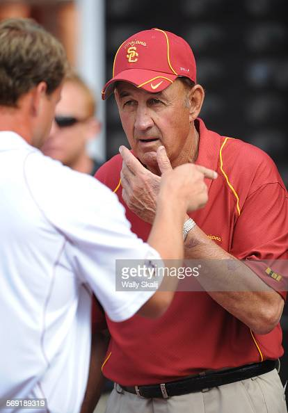 USC football coach Monte Kiffin speaks to his son and USC head coach Lane Kiffin left prior to the season opening game in Hawaii on 9/2/2010