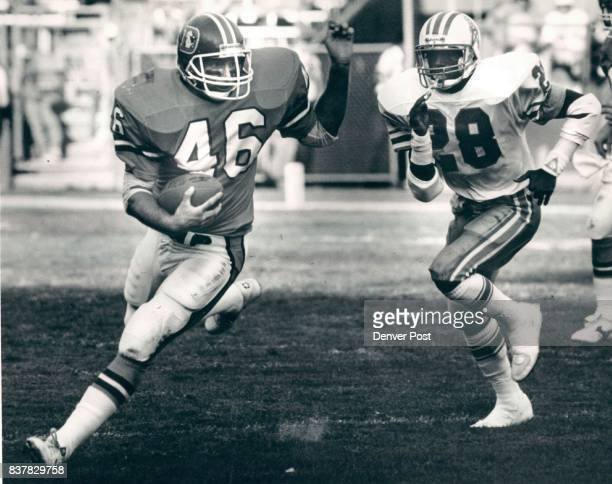 Football Denver Broncos 1987 Game 4 Oilers Emmuel Thompson in pirsuit of Broncos Bobby Micho in the 2nd quarter Credit The Denver Post