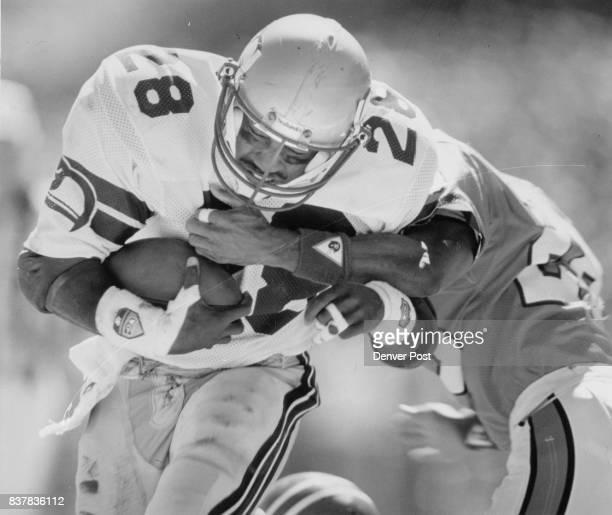 Football Denver Broncos 1988 Game 1 Seahawks 21 Broncos 14 Curt Warner ***** Wks Curt Warner carries for TD taking bronco RCB Jeremiah Castille with...