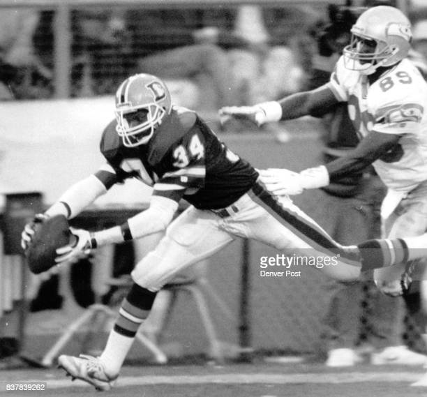 Football Denver Broncos 1989 November Games Bronco Corner back Tyrone Braxton intercepts a Dave kreig pass in the end zone late in the third quarter...