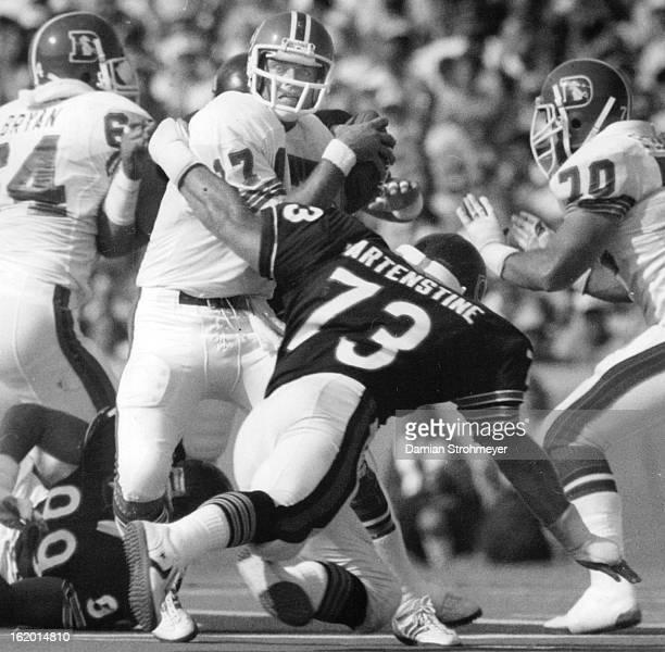 OCT 3 1983 Football Denver Broncos Bear's Mike Hartenstine helps in sacking Broncos quarterback Steve DeBerg one of the nine sacks against Denver