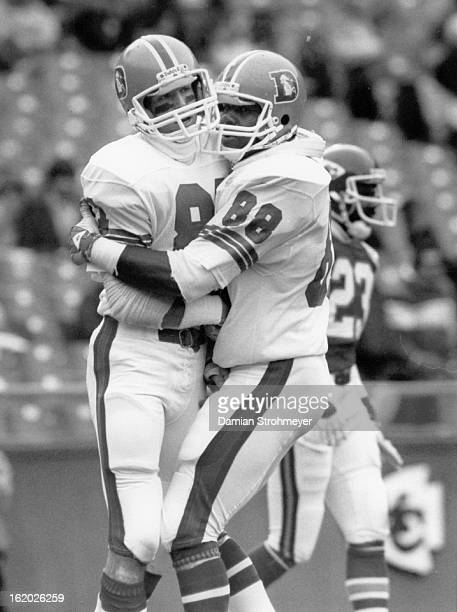 NOV 1 1984 DEC 3 1984 Football Denver Broncos Clarence Kay congratulates Watson on his TD catch