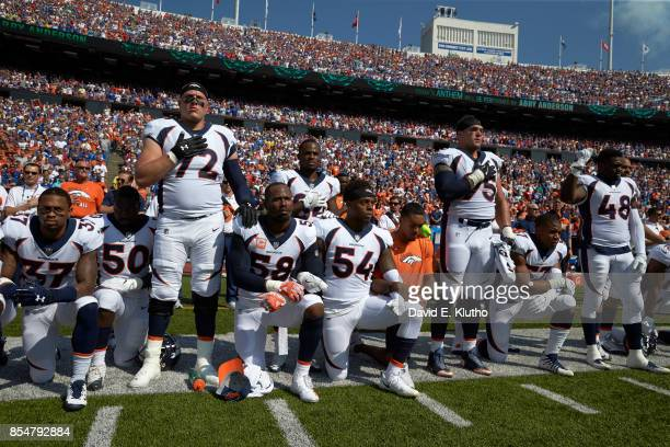 Denver Broncos Garett Bolles Derek Wolfe and Shaquil Barrett with teammates kneeling and linking arms in a show of solidarity during the National...