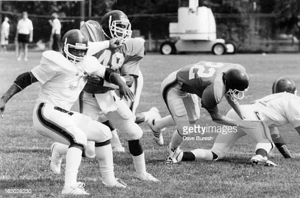 JUL 24 1984 JUL 25 1984 Football Denver Broncos Jesse Myles begins to pivot around