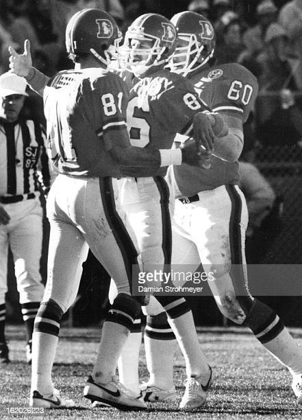 NOV 4 1984 NOV 5 1984 Football Denver Broncos Johnson congratulates Watson after Watson scored the first touchdown of the day for Denver
