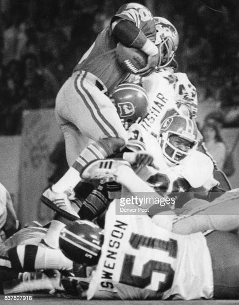 Football Denver Broncos King drives over the Denver defense for the winning touchdown in the early 4th quarter Bill Thompson screams as he is hurt on...