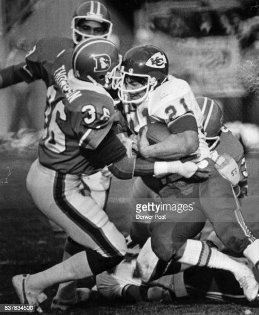 Football Denver Broncos Morgado goes left side to be stopped by Billy Thompson Face to face Crashing enamel Credit Denver Post