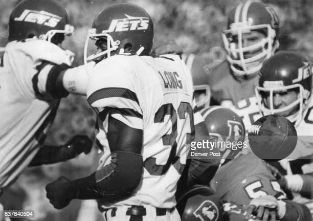 Football Denver Broncos New York Jets' Kevin long heads one way Ball the other on big turnover in first period Denver's Bill Thompson picked up ball...