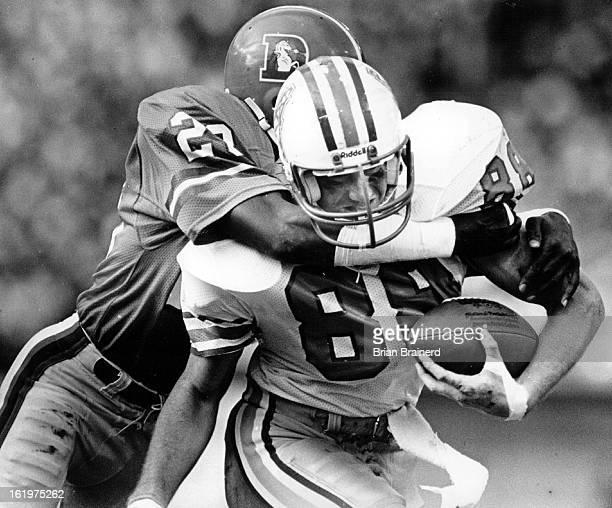 OCT 7 1985 Football Denver Broncos Roger Jackson gives Oilers Chris Dressel a bear hug tackle in the second half