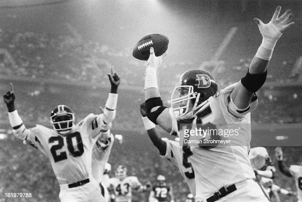 OCT 7 1984 OCT 8 1984 Football Denver Broncos Rulon holds the ball aloft after he 'intercepted' a Billy Sims fumble and rambled in for a list period...