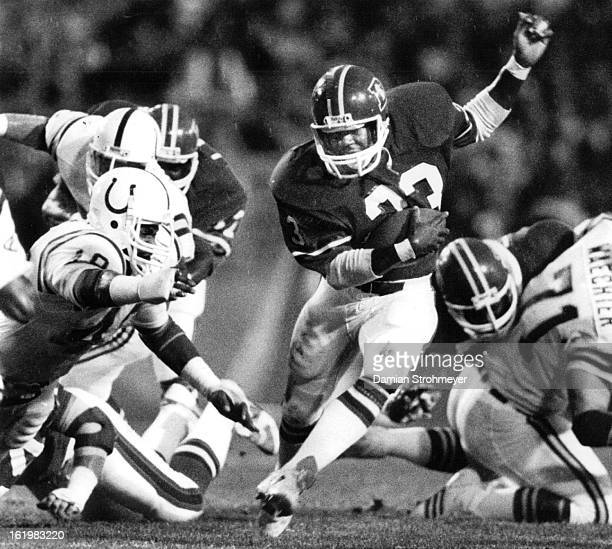 AUG 19 1984 Football Denver Broncos Sammy Winder cuts through colts defense for a Denver ga in