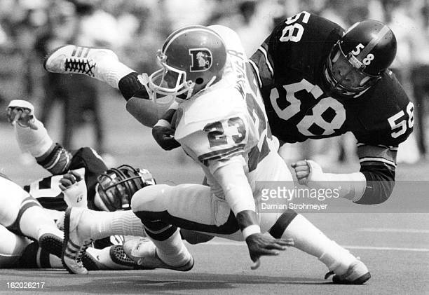 OCT 6 1984 OCT 7 1984 Football Denver Broncos Sammy Winder hurtles by Jack Lambert enroute to the goal line for the first touchdown of the regular...