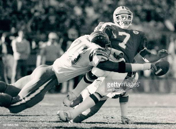 NOV 8 1984 DEC 10 1984 Football Denver Broncos San Diego defensive end Keith Ferguson jars the ball loose from sliding John Elway during a first...