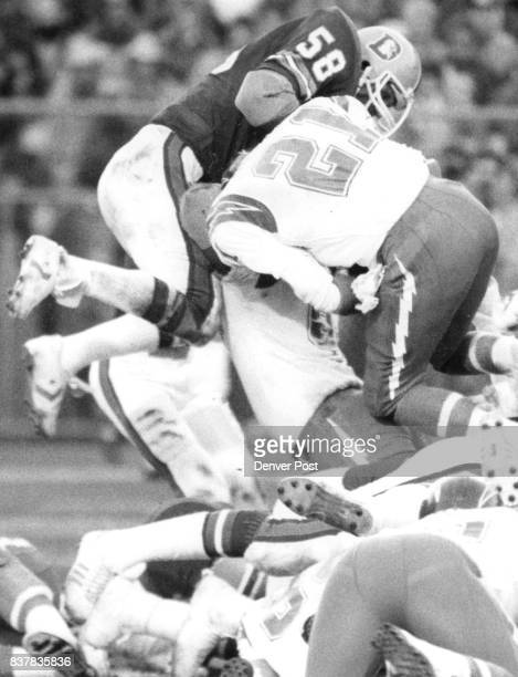 Football Denver Broncos Steve Busick slams into Charger running back Buford McGee during Denver goal line stand which held San Diego four times...