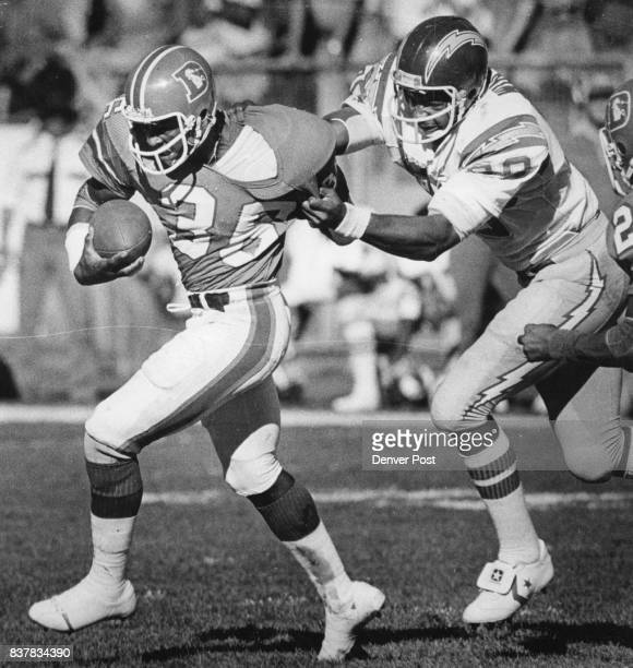 Football Denver Broncos The Cover Billy Thompson tries to pull away from San Diego's Kellen Winslow after intercepting a Dan Fouts pass Sunday in the...