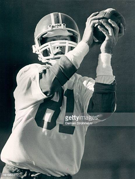 NOV 18 1984 DEC 20 1984 Football Denver Broncos Wide receiver Steve Watson hauls in a pass during today's abbreviated practice session