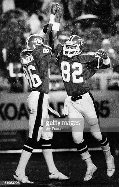 AUG 19 1984 Football Denver Broncos Zach Thomas celebrates his long pass reception with a high five with teammate Alexander