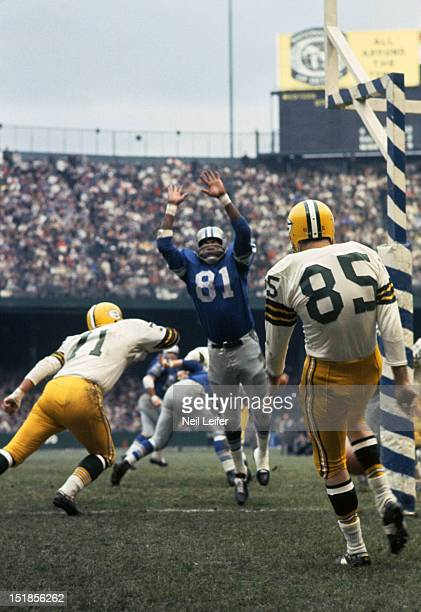 Detroit Lions Dick Lane in action jumping to attempt punt block vs Green Bay Packers Max McGee at Tiger Stadium Sequence Detroit MI CREDIT Neil Leifer